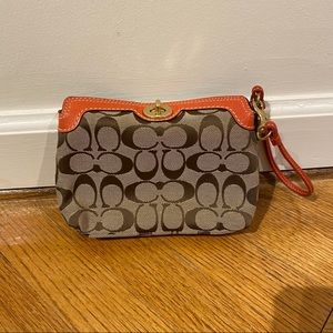 Coach wristlet bag with orange leather